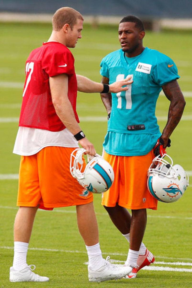 To develop better chemistry in the passing game, Tannehill is keeping Wallace at arm's length and getting in extra work after practice at Dolphins camp.