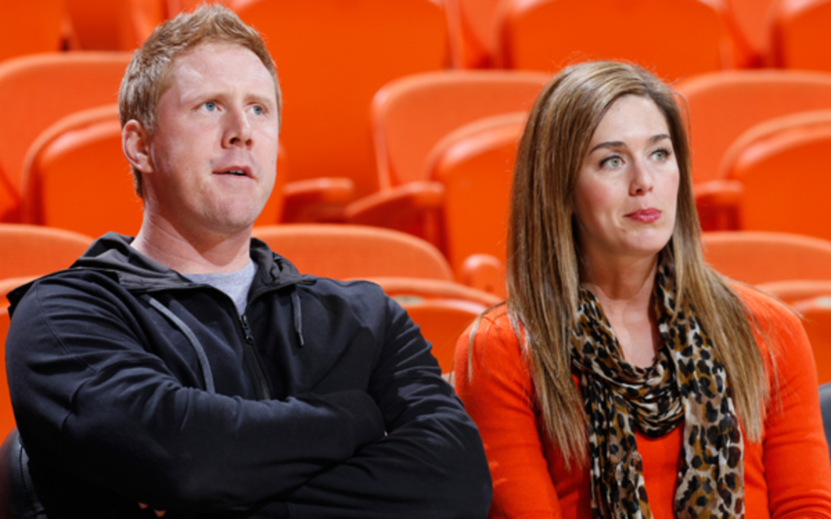 Brandon Weeden and his wife, Melanie, experienced anxious moments for family members Monday as a tornado bore down on Moore, Okla. (Joe Robbins/Getty Images)