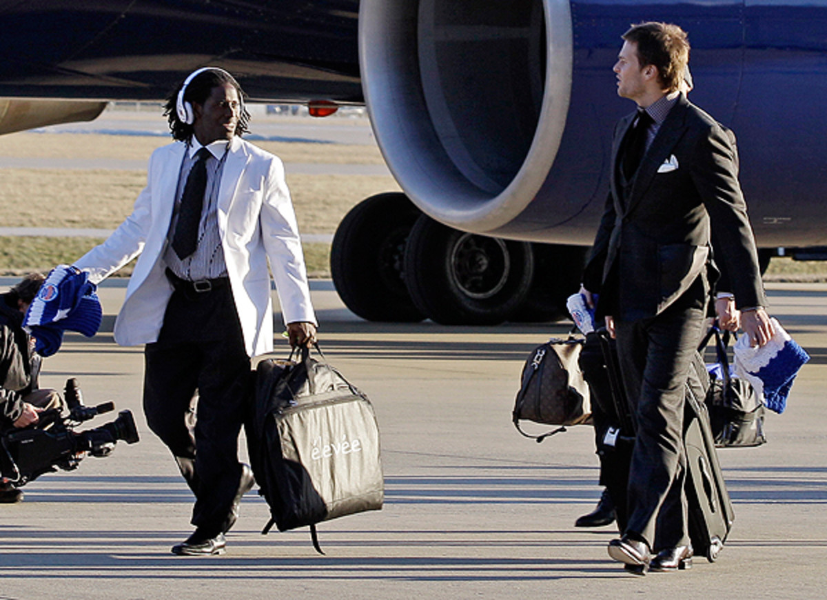 Tom Brady appears to be hoping to get Deion Branch (left) back on the plane.
