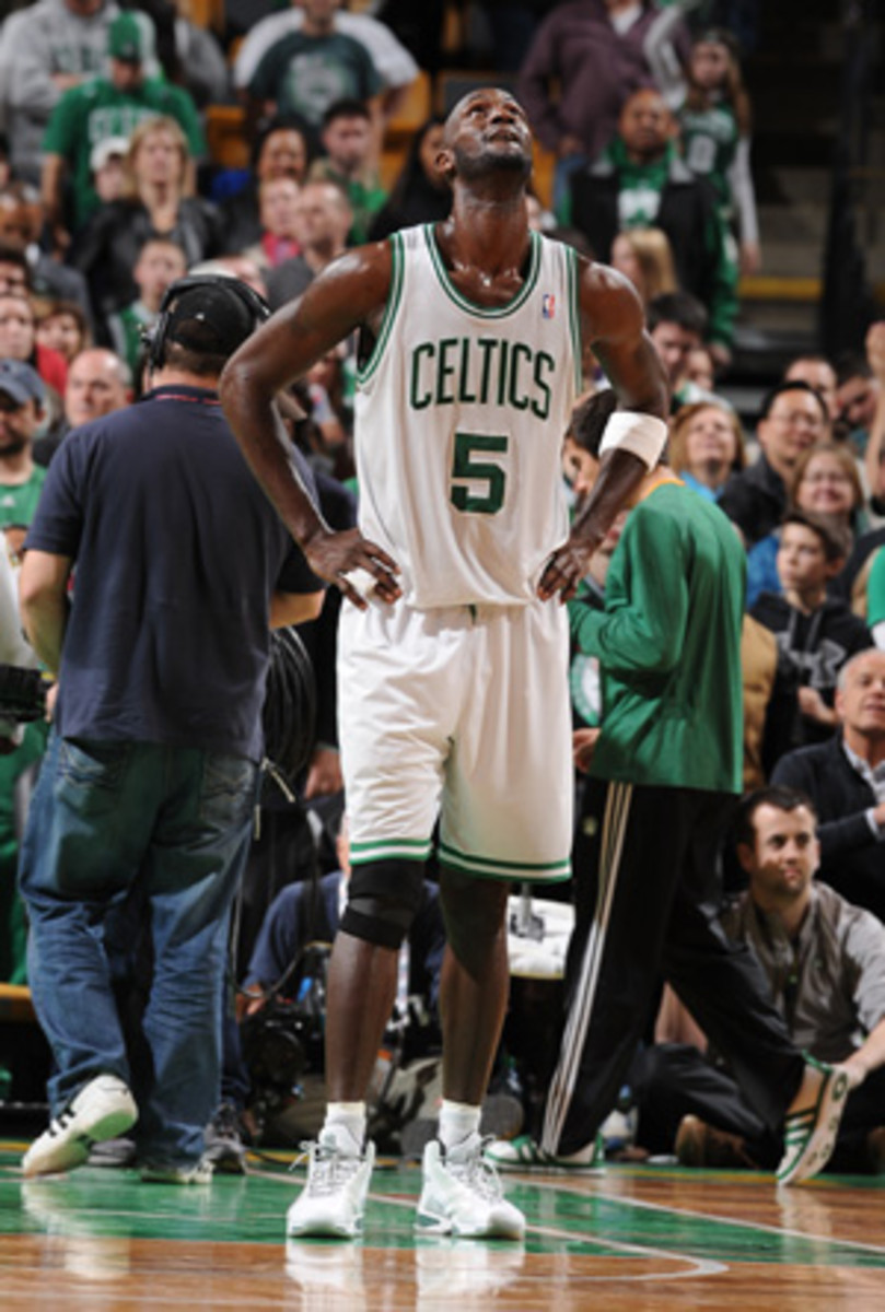 Kevin Garnett could miss two weeks with an ankle injury. (Andrew D. Bernstein/Getty Images)