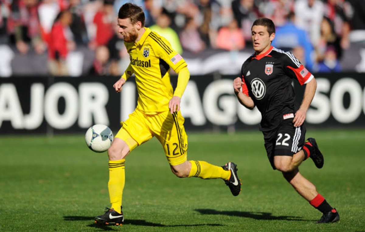 Columbus midfielder Eddie Gavens runs from D.C. United's Chris Korb in Saturday's 2-1 win for the Crew.