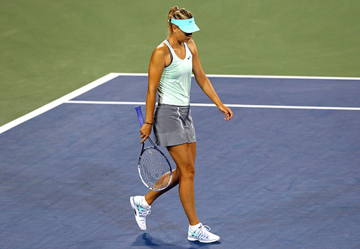 Maria Sharapova crashed out in the opening match of her first tournament with Jimmy Connors as her coach. (Ronald Martinez/Getty Images)