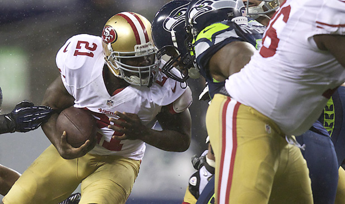 Would this be a penalty on Frank Gore? Refs might have a hard time deciding on that now. ( Stephen Brashear/Getty Images)