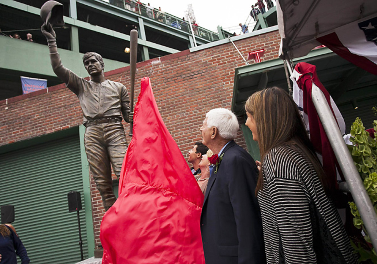 Carl Yastrzemski watches as his statue is unveiled outside of Fenway Park on Sunday.