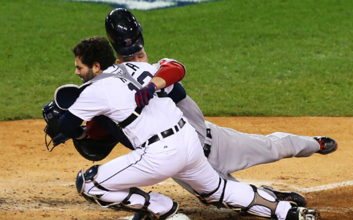 Tigers catcher Alex Avila left Thursday night's Game 5 of the ALCS after this collision. (Ronald Martinez/Getty Images)