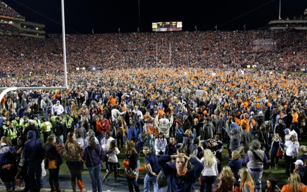 This wild scene after Auburn's victory over Alabama last month cost the school a $5,000 fine. (AP Photo/Jay Sailors)