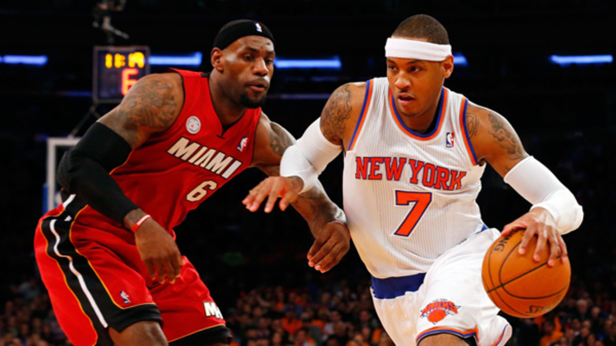 Carmelo Anthony, right, has passed LeBron James on the NBA's jersey sales list. (Jim McIsaac/Getty Images)
