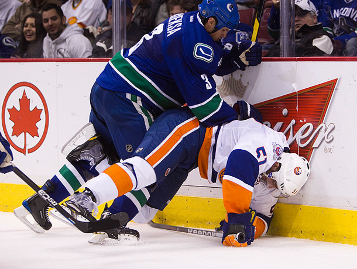 The NHL has worked to reduce dangerous hits like this that result in head injuries. (Bob Frid/Icon SMI)