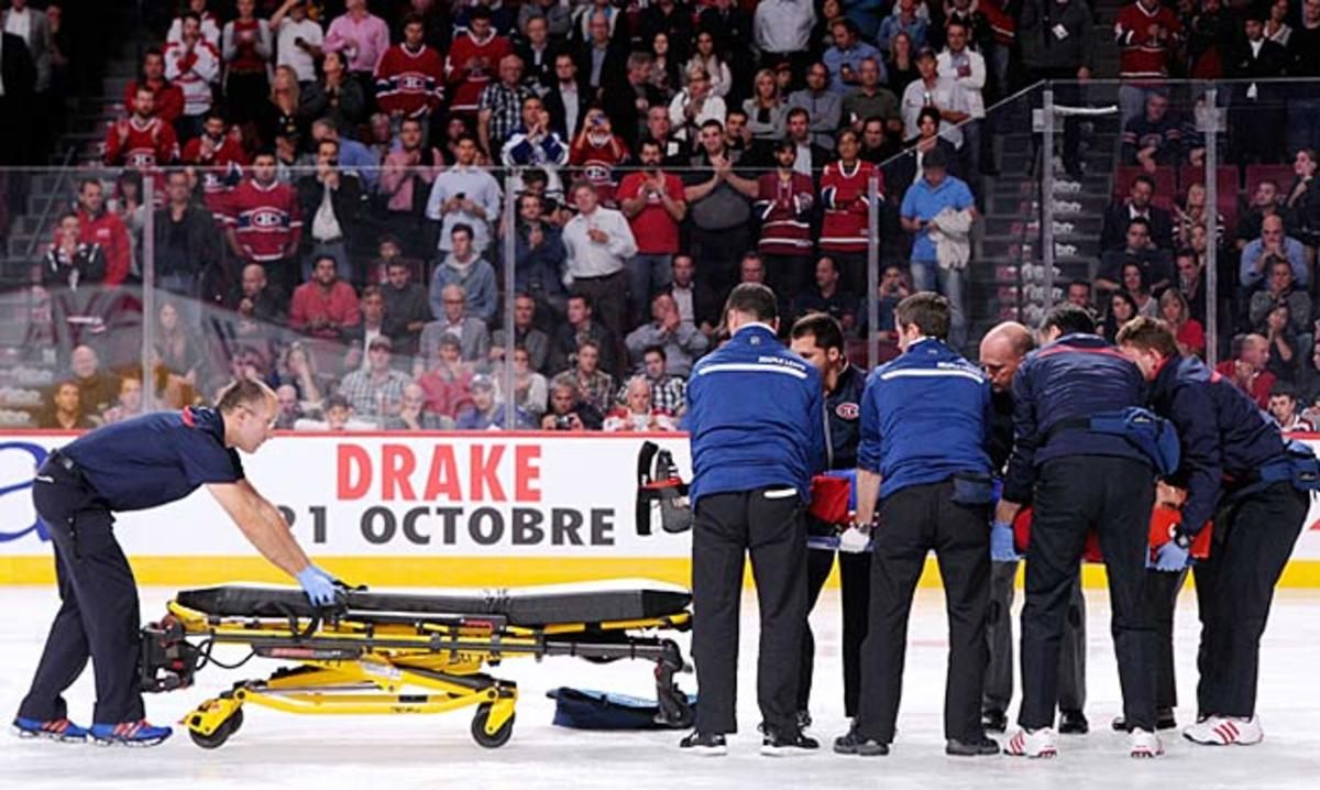 George Parros of the Montreal Canadiens is loaded onto a stretcher.