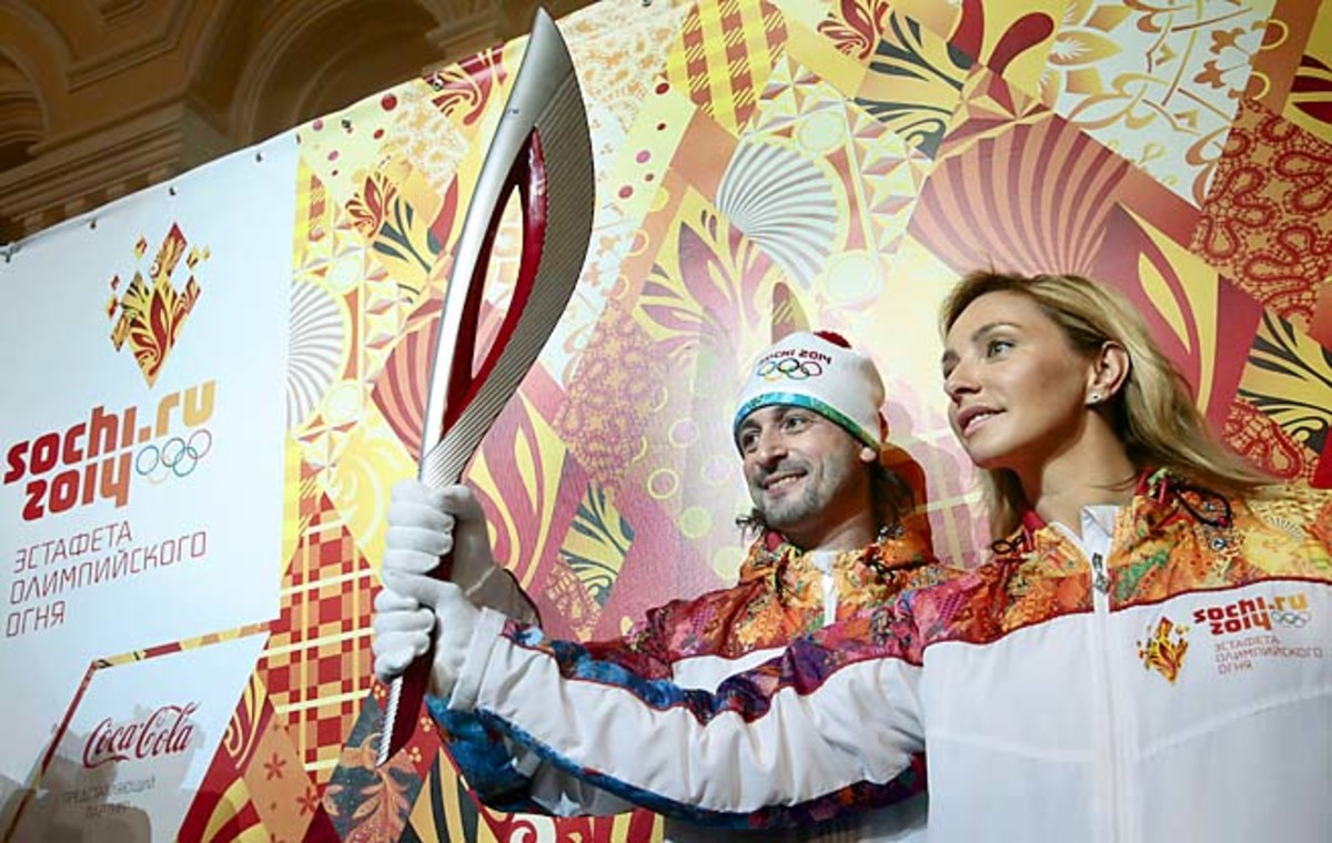 Russian ice dancing champs Ilia Averbukh (left) and Tatyana Navka present the Olympic torch earlier this year.