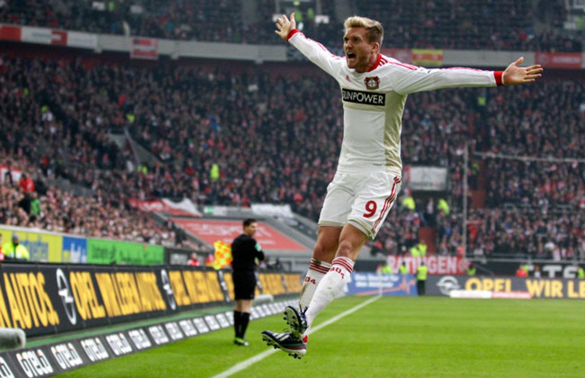 Andre Schuerrle celebrates after scoring for Bayer Leverkusen in March.