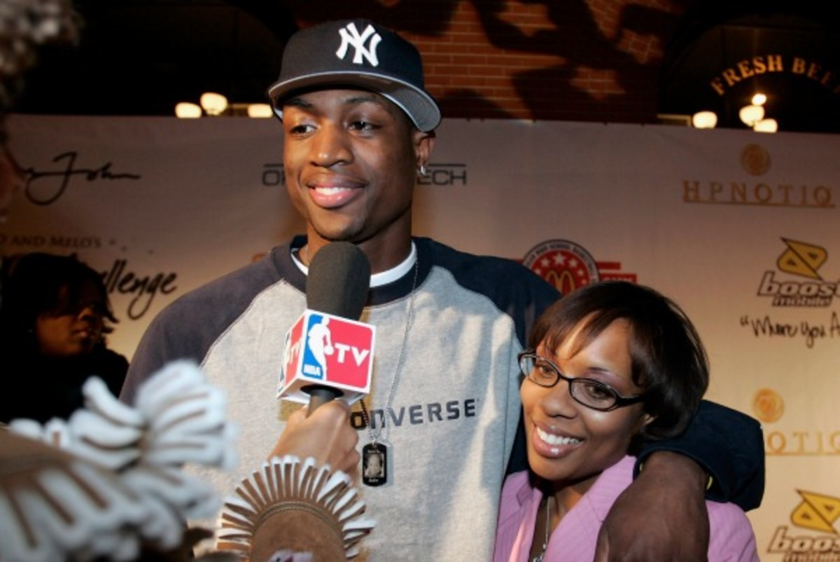 Dwyane Wade and ex-wife Siohvaughn Funches-Wade, shown here in 2005, have reached a settlement in their divorce (Layne Murdoch)