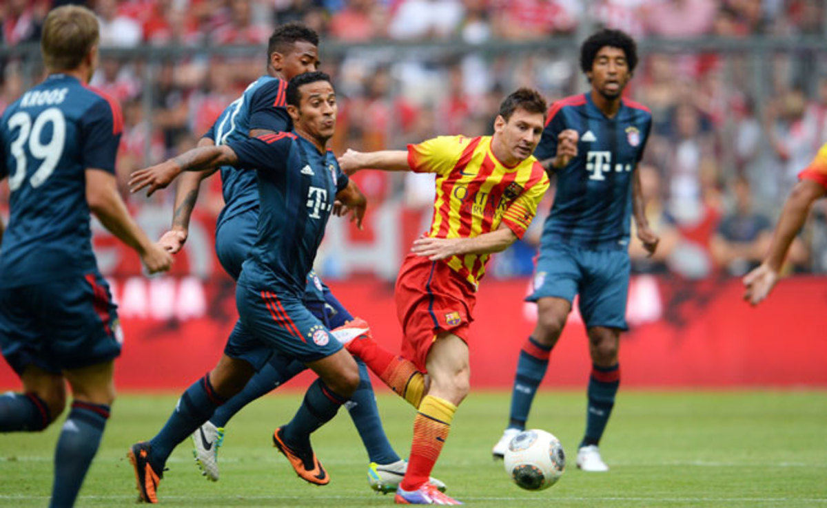 Goals by Phillip Lahm and Mario Mandzukic were enough to defeat Lionel Messi and Barcelona in a friendly.