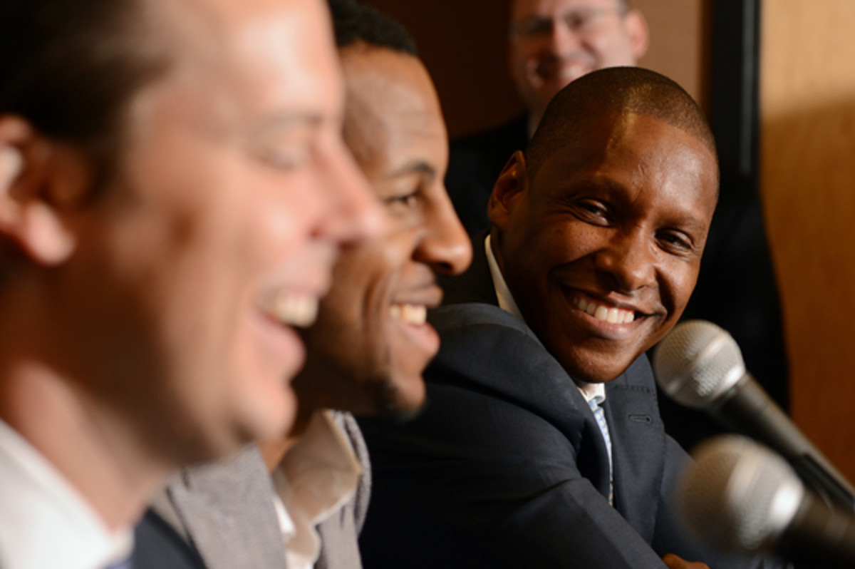 Masai Ujiri, right, has been named 2013 Executive of the Year. (Garrett Ellwood/Getty Images)