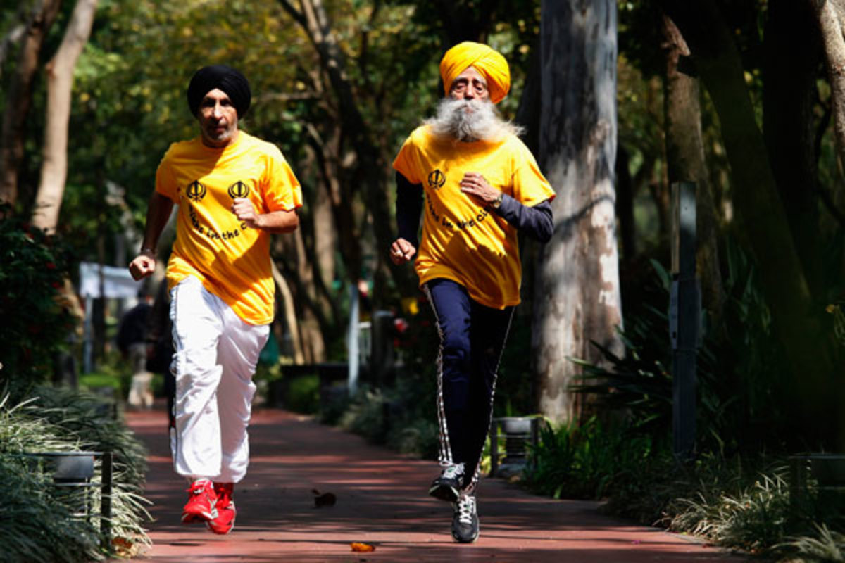 Singh jogs with his trainer, Harmander Singh, before the marathon. (Reuters)