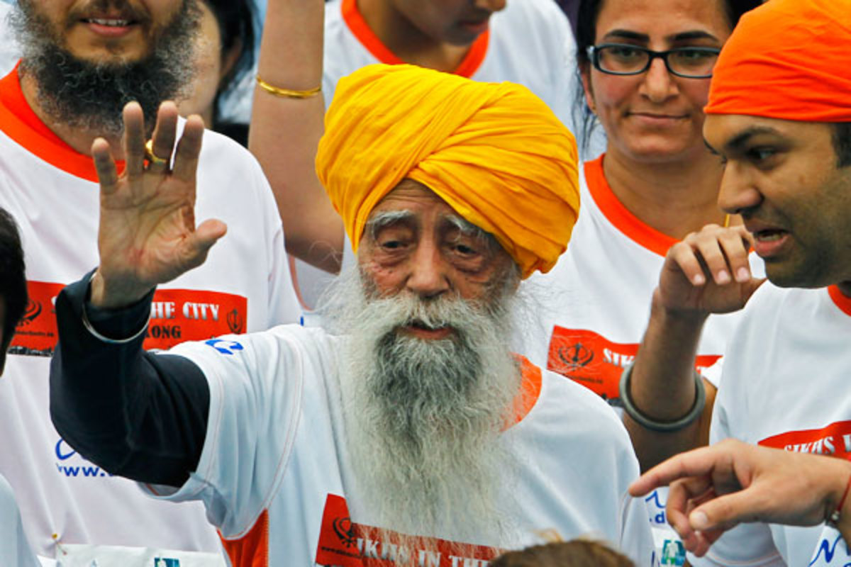 Singh waves after completing the race. (AP)