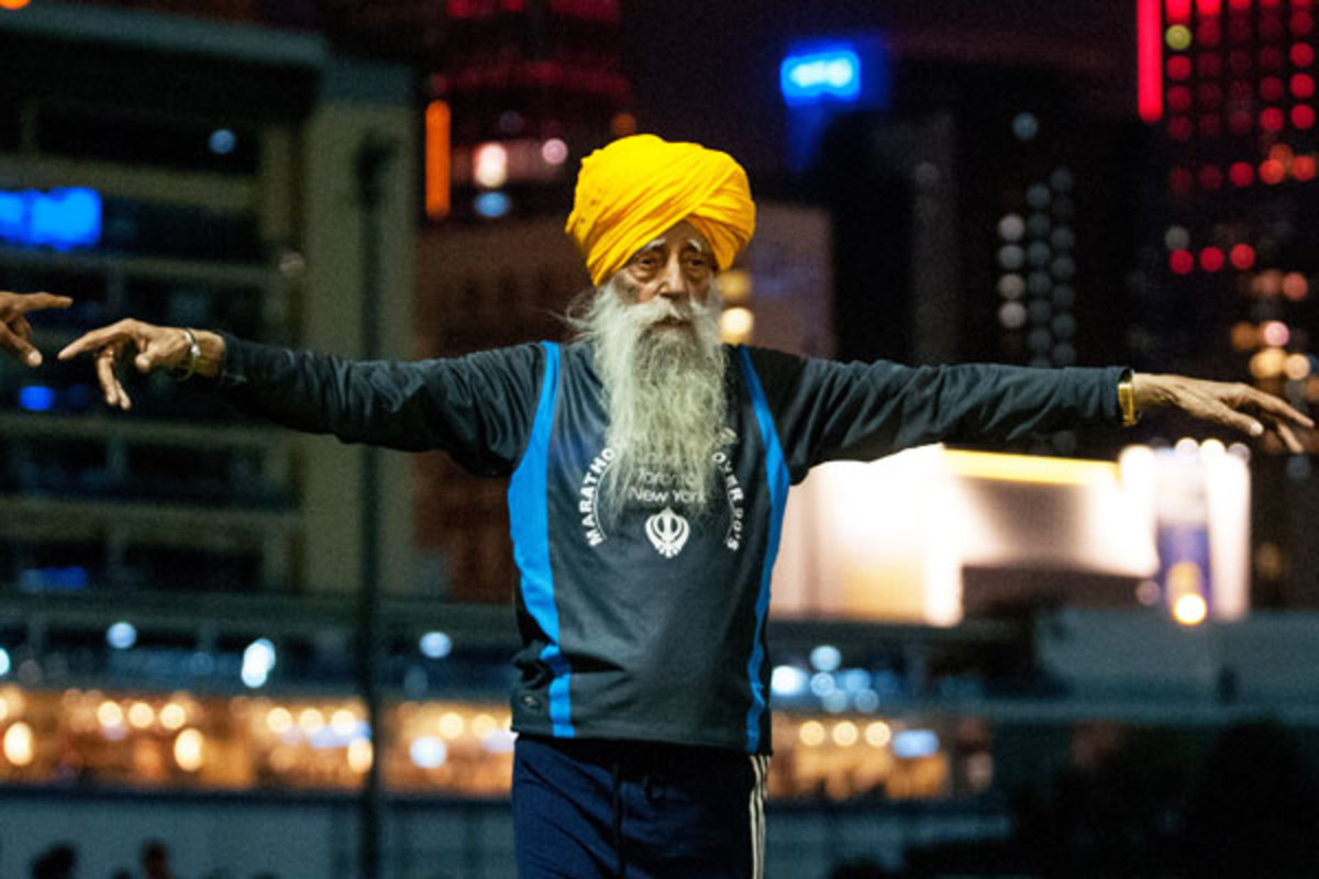 Faujah Singh, 101, warms up ahead of the Hong Kong Marathon. (Getty Images)