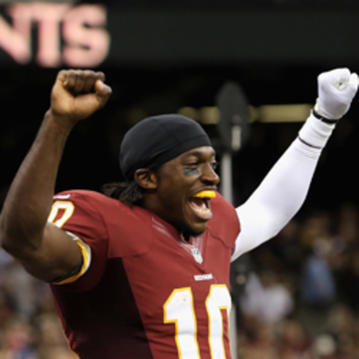 Redskins coach Mike Shanahan said  quarterback Robert Griffin will set a record for recovery from knee surgery. (Robert Martinez/Getty Images)