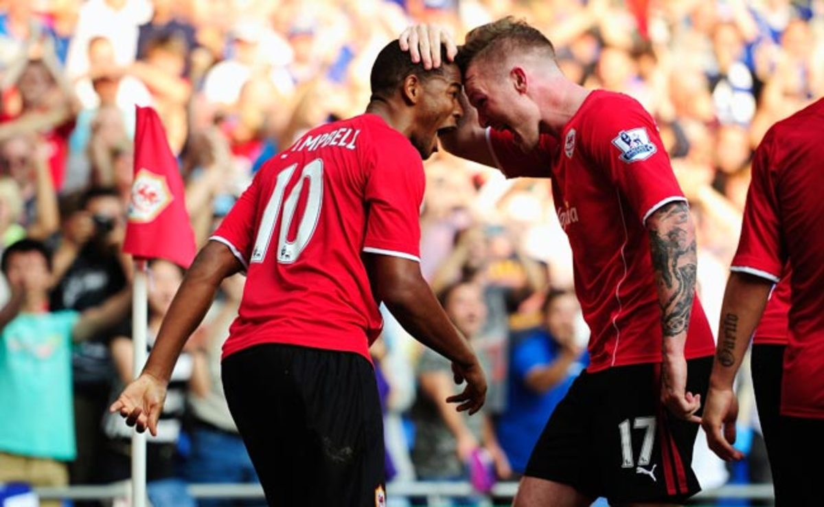 Fraizer Campbell celebrates with Aron Gunnarsson after taking a 3-1 lead over Manchester City.