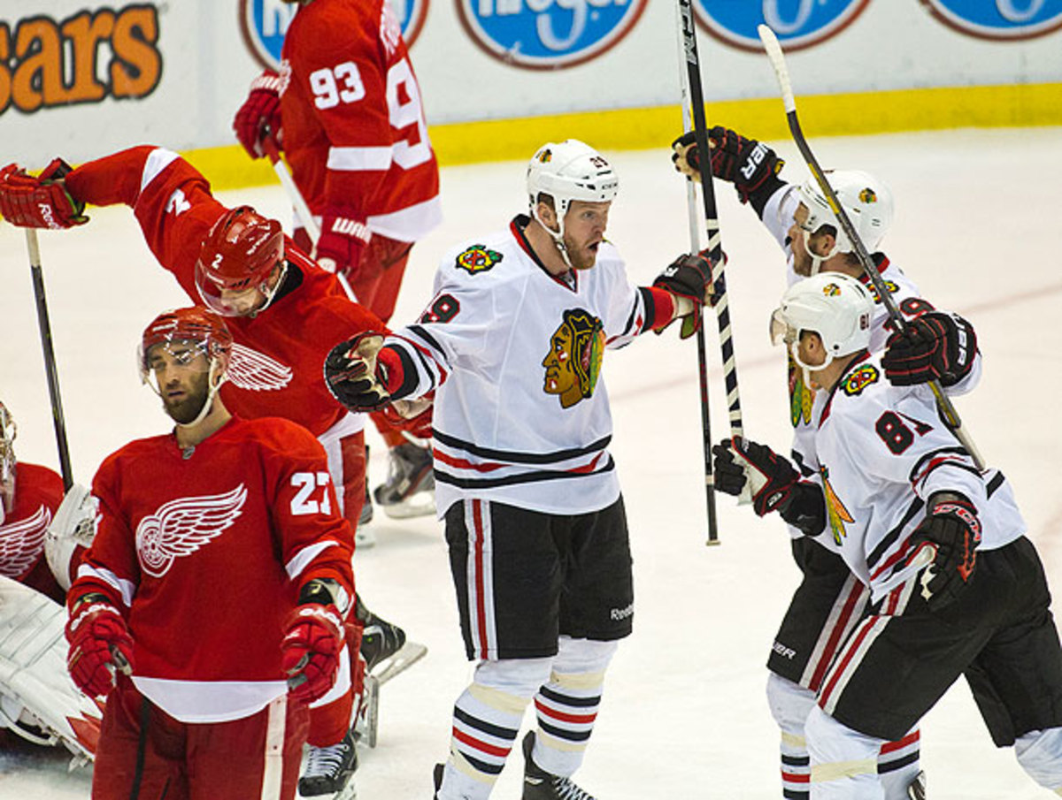 Bryan Bickell (center) scored a key goal after being moved up to Chicago's first line. (Tony Ding/Icon SMI)