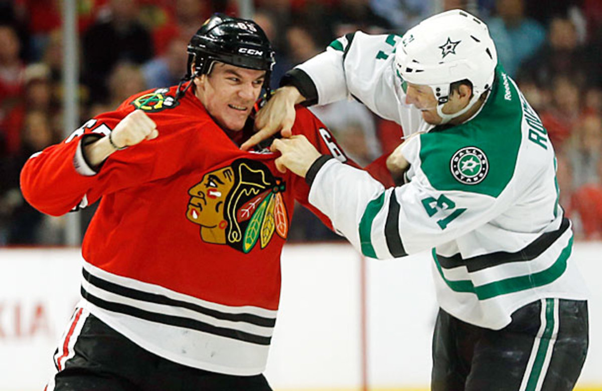 Andrew Shaw of the Chicago Blackhawks fights Antoine Roussel of the Dallas Stars.