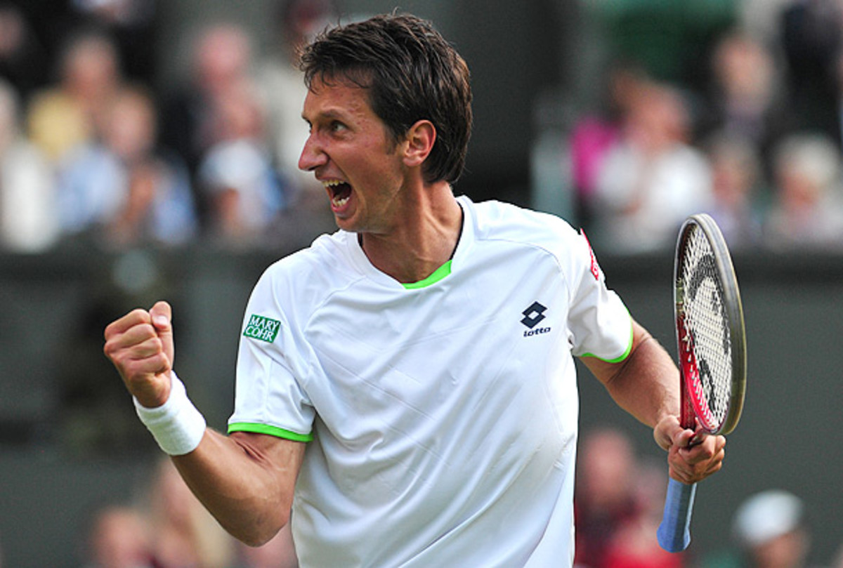 Sergiy Stakhovsky ousted Roger Federer 6-7 (5), 7-6 (5), 7-5, 7-6 (5) in the second round at Wimbledon this year. (Carl Court/AFP/Getty Images)
