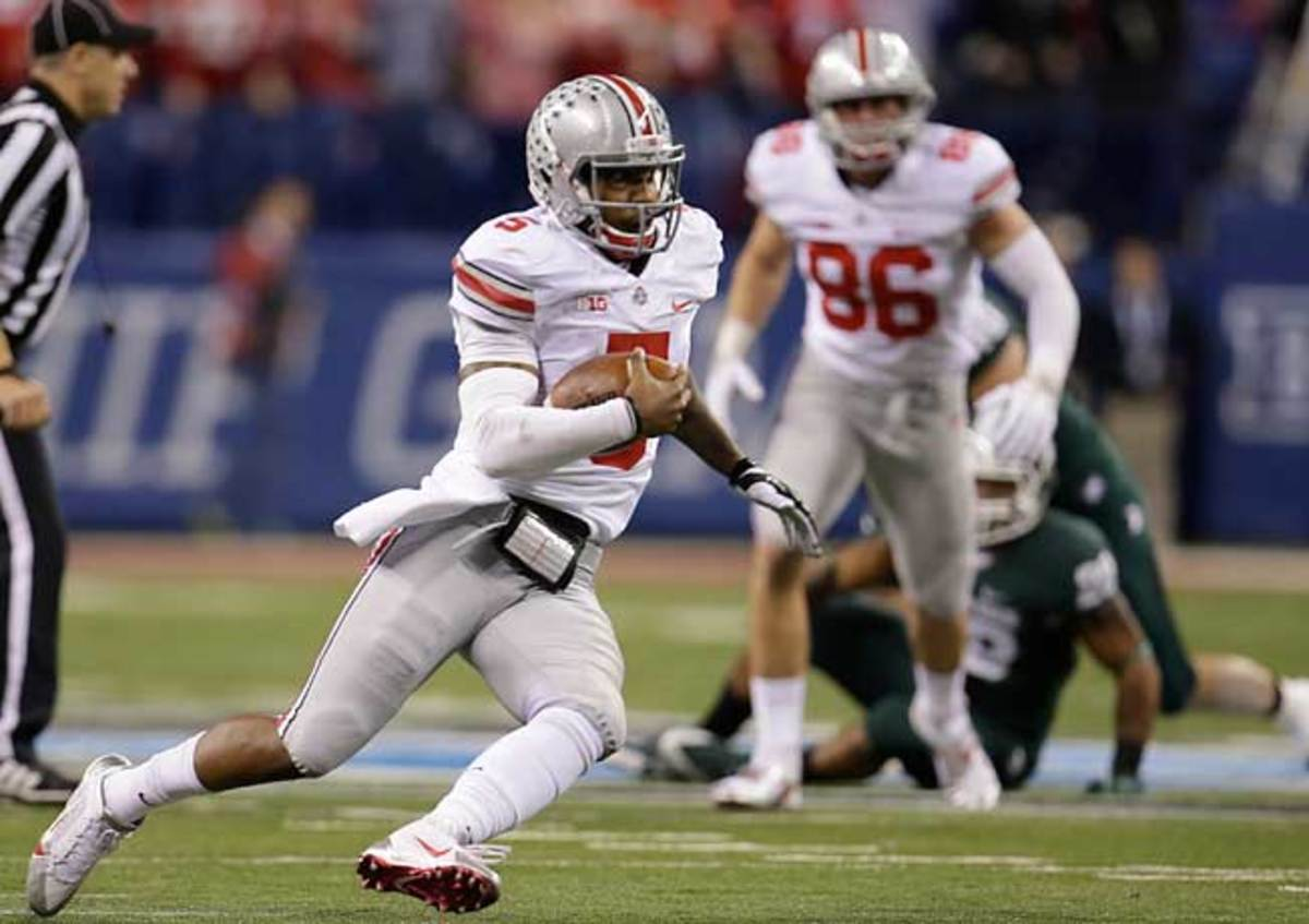 Ohio State QB Braxton Miller (5) ran for 1,033 yards and 10 TDs in 2013. (AP Photo/AJ Mast)