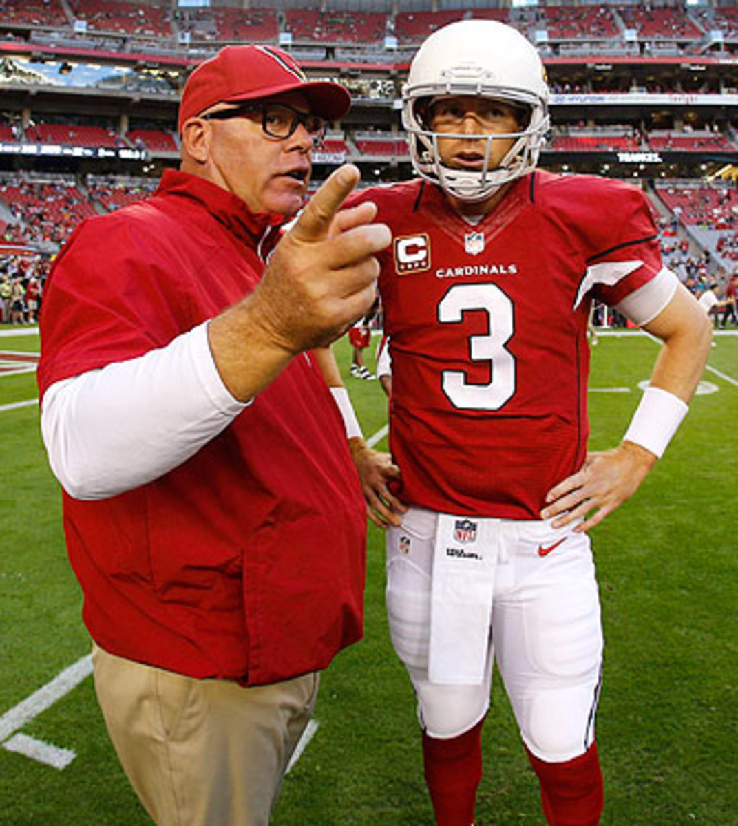 In their first season working together, it took Arians and Palmer awhile to get on the same page. (Ric Tapia/AP)
