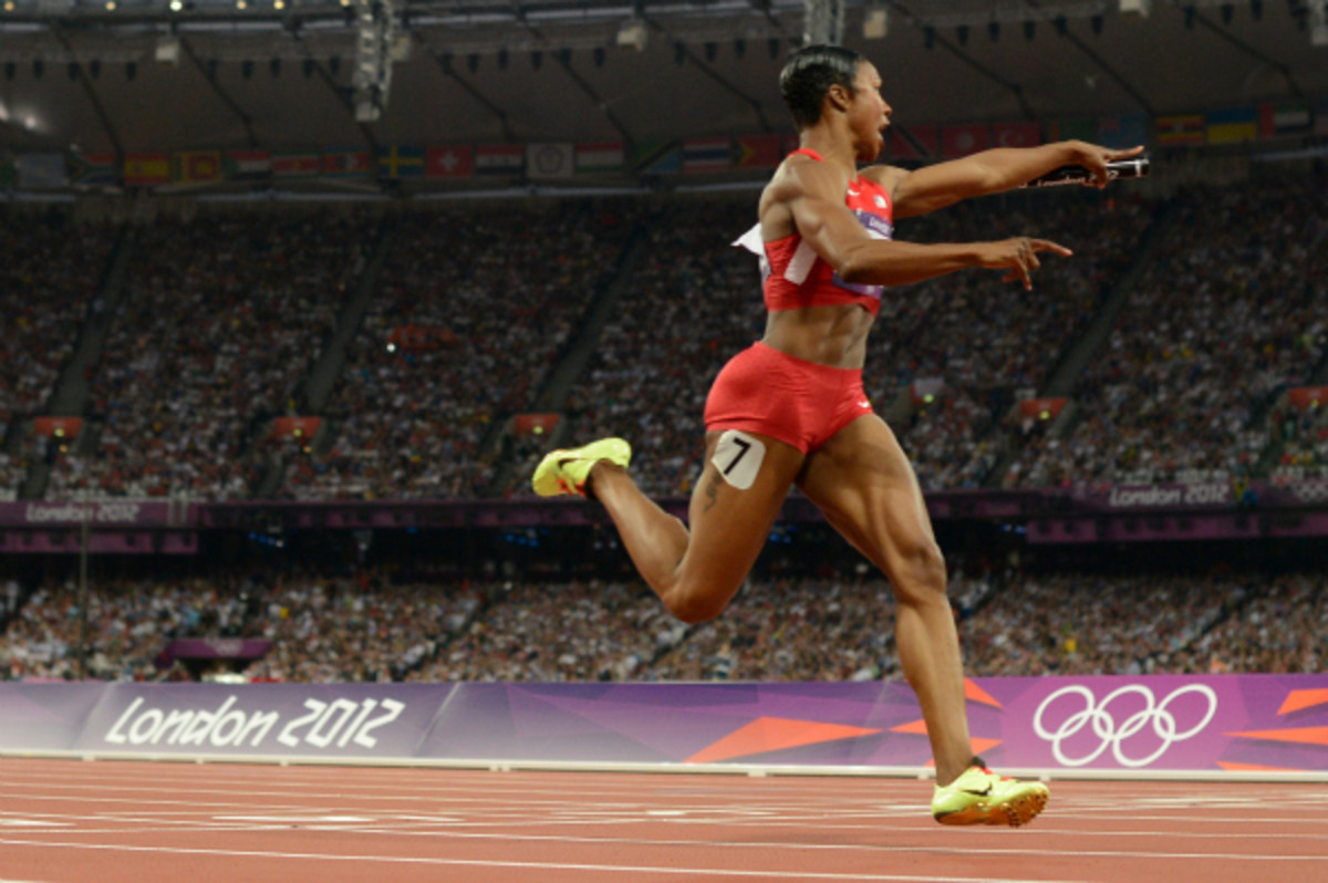 Carmelita Jeter, who helped Team USA to a gold in the 400-meter relay in London, will skip the national championships to nurse a sore quadriceps. (Adrian Dennis/Getty Images)