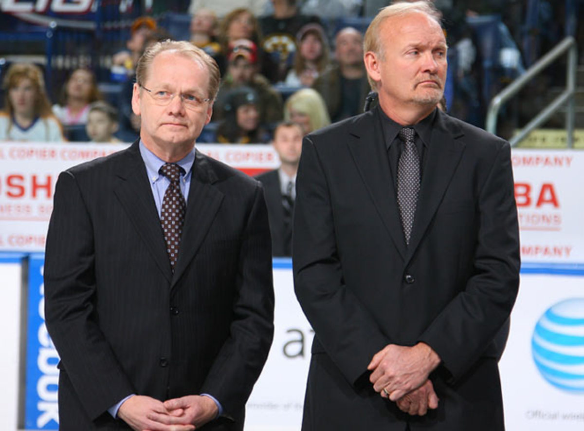 When Sabres coach Lindy Ruff (right) was fired, people wondered why GM Darcy Regier (left) survived.