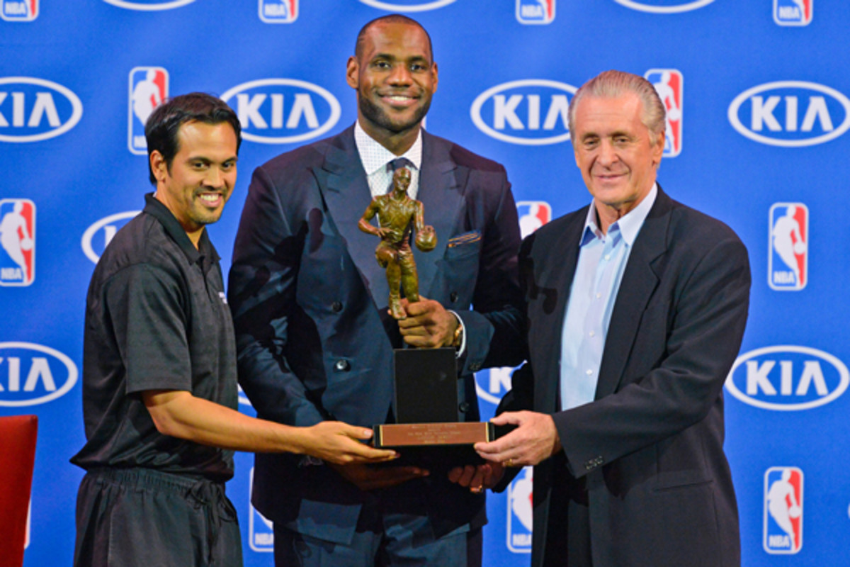 LeBron James, center, poses with the 2013 MVP trophy, flanked by coach Erik Spoelstra and Heat president Pat Riley. (Jesse D. Garrabrant/Getty Images)