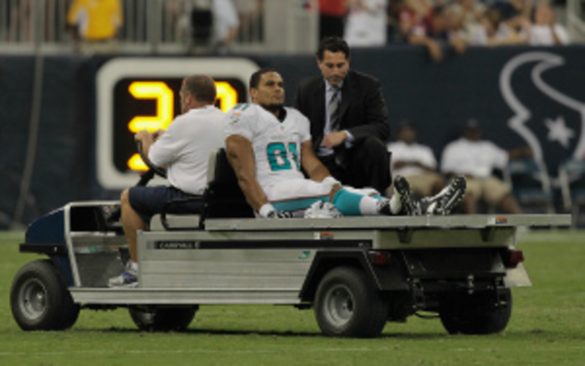 NFL owners could vote in March whether to ban hits to the knees of defenseless players, such as the one this preseason that ended Miami Dolphins tight end Dustin Keller's year. (Bob Levey/Getty Images)