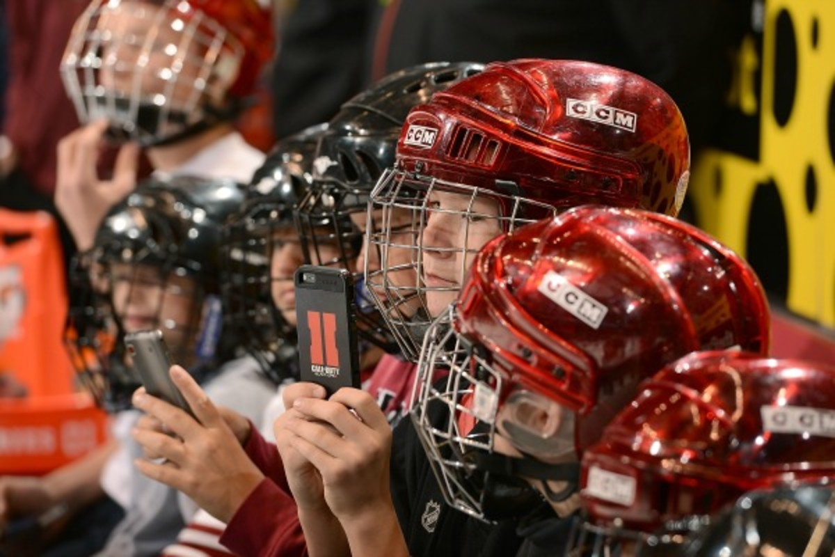 The scene at a youth hockey game in Florida was not as idyllic as this scene. (Norm Hall/Getty Images)