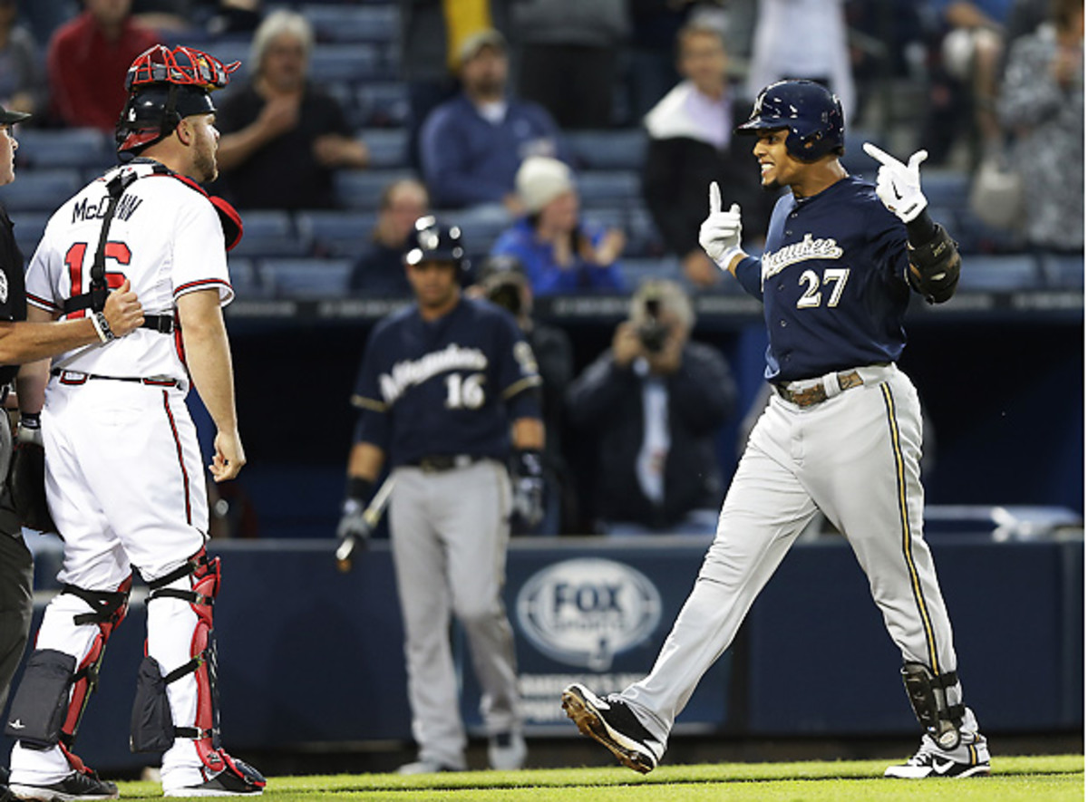 Brian McCann (left) took serious exception to Carlos Gomez's response after hitting a home run. (AP)