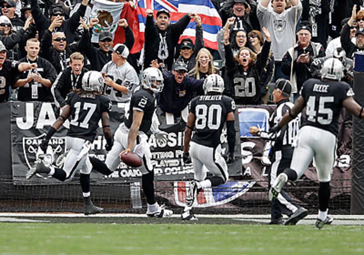 Terrelle Pryor set records for the longest run by a quarterback ever, and the longest run in Raiders history, with his 93-yard touchdown score early against the Steelers. (Ezra Shaw/Getty Images)