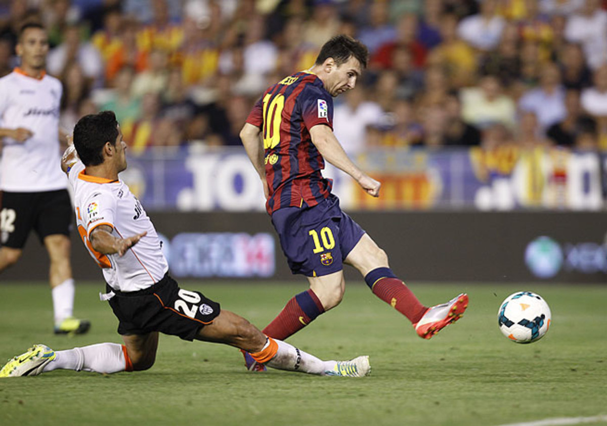 Barcelona's Lionel Messi (right) notched a hat trick in the first half against Valencia.