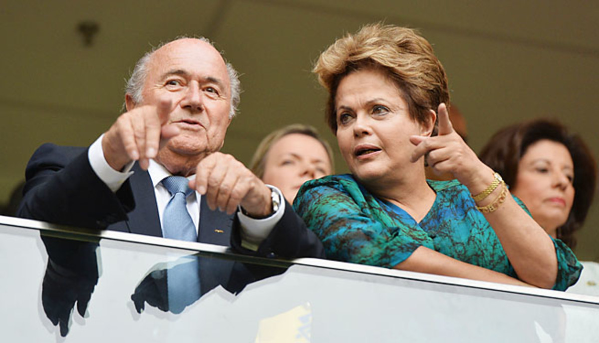 FIFA president Sepp Blatter looks on with the Brazil president Dilma Rousseff at a Confederations Cup match.