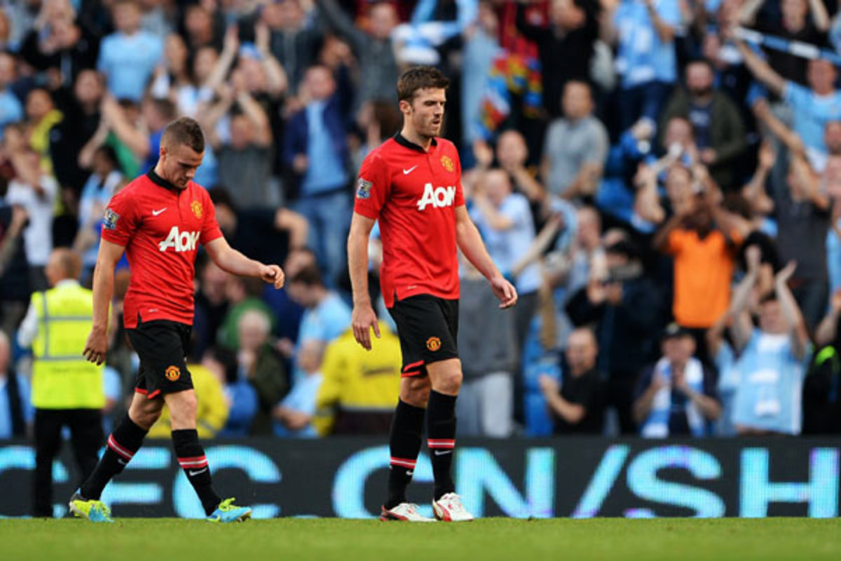 32-year-old Michael Carrick (right) struggled in the midfield against Yaya Toure. (Michael Regan/Getty Images)