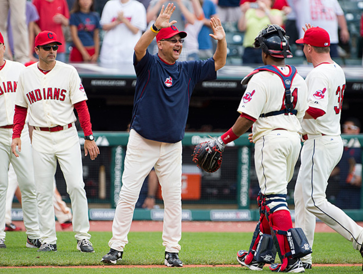 Terry Francona (center) guided the Indians to the playoffs in his first year as Cleveland manager. (Jason Miller/Getty Images)
