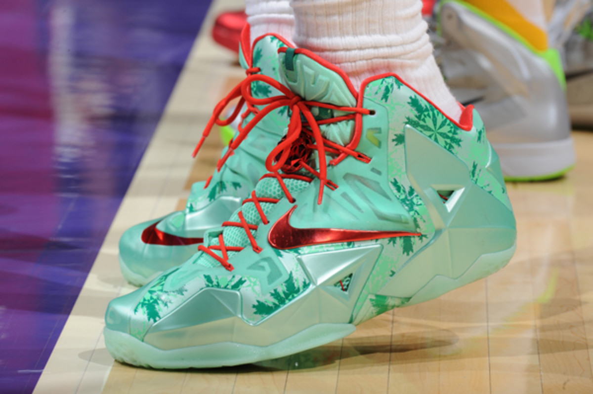 LeBron James wearing the Christmas colorway of his signature Nike sneakers.  (Andrew D. Bernstein/Getty Images)