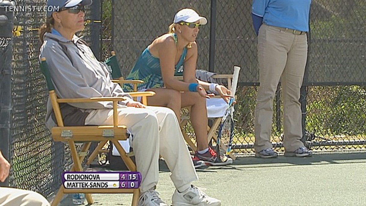 Rodionova takes a seat on the baseline after complaining to the umpire about moisture on the courts in the second set.