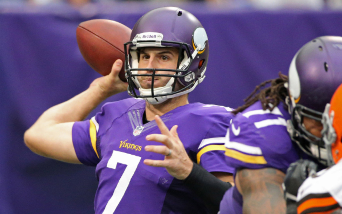 Christian Ponder is not happy with the Vikings' quarterback situation. (Tom Dahlin/Getty Images)