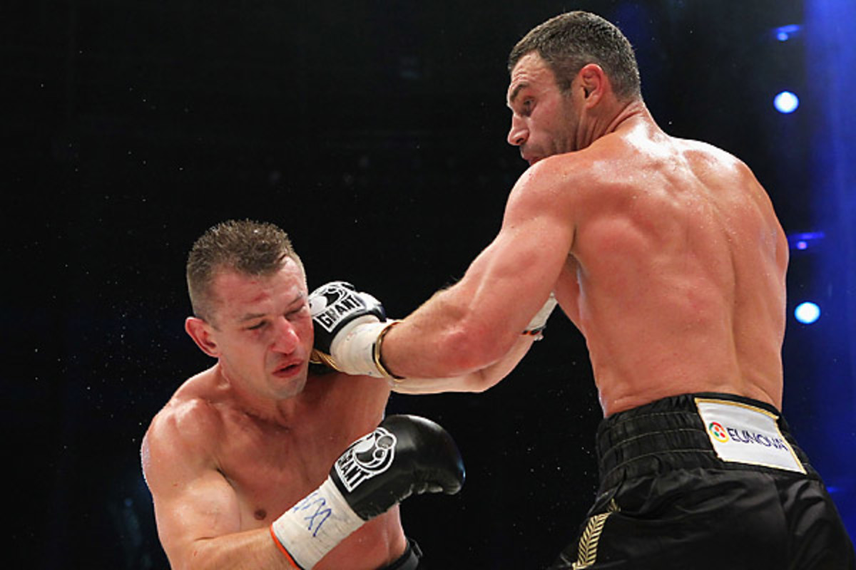 Tomasz Adamek (left) took some time off from boxing to sharpen his game. (Boris Streubel/Getty Images)