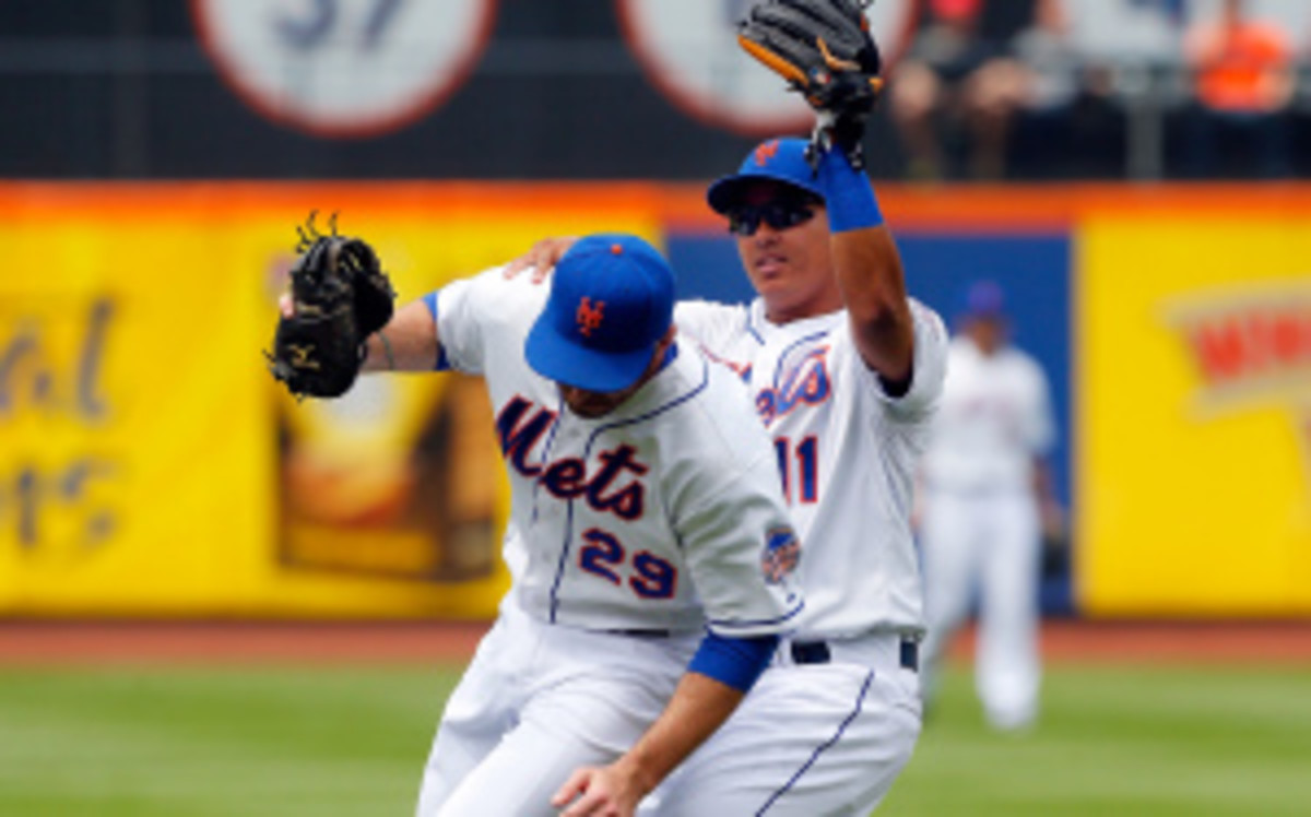 A demotion to the minors  for Ike Davis and Ruben Tejada is reportedly being considered by the Mets. (Jim McIsaac/Getty Images)