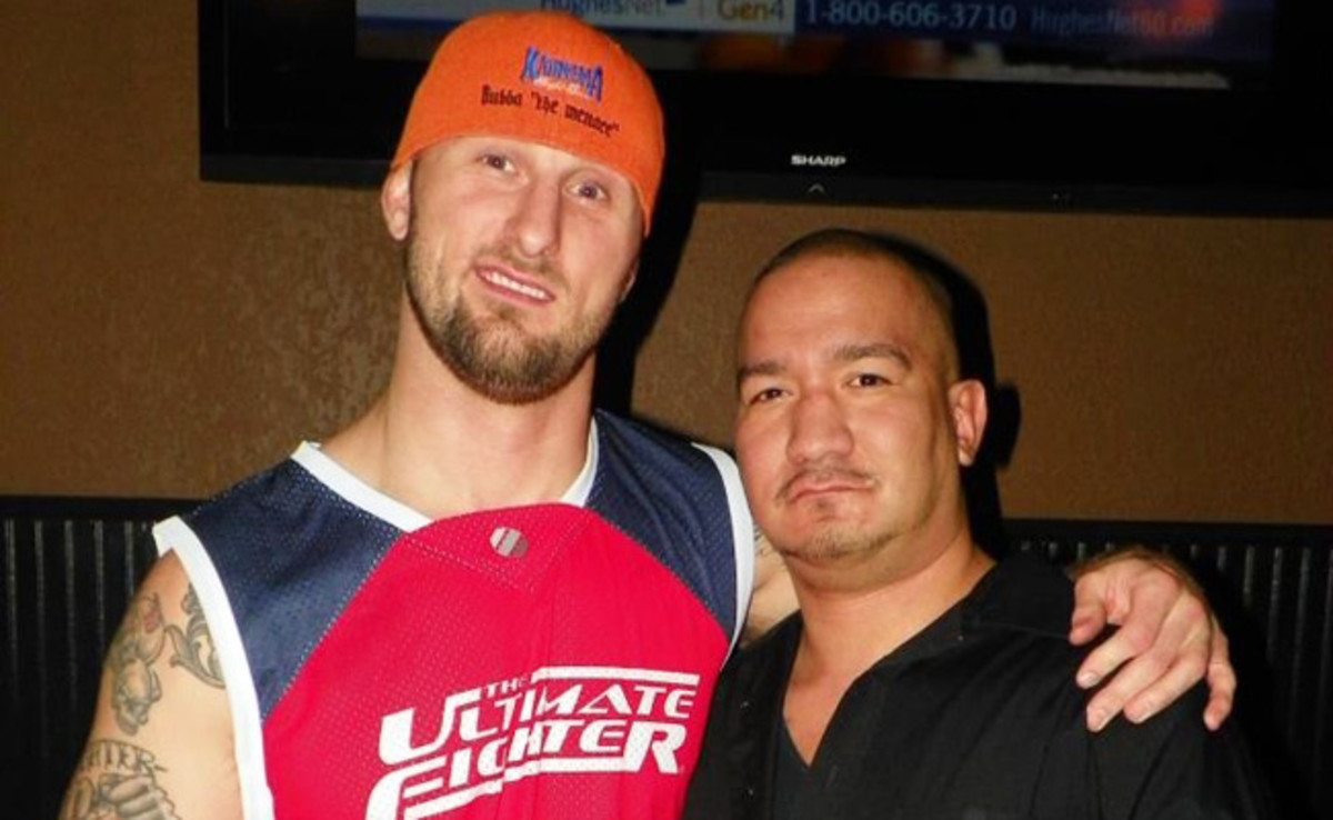 Bubba McDaniel embraces his close friend Jason Hernandez the night of the 'Ultimate Fighter' premiere.