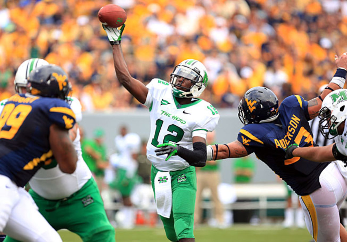 Marshall's Rakeem Cato (12) will look to build off his 2012 campaign, when he passed for 4,201 yards.