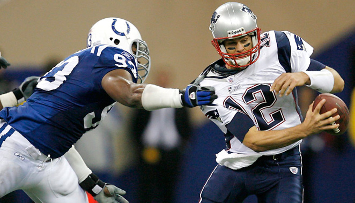 Dwight Freeney chased Tom Brady for years. Now Brady's extension could lead to them being teammates.