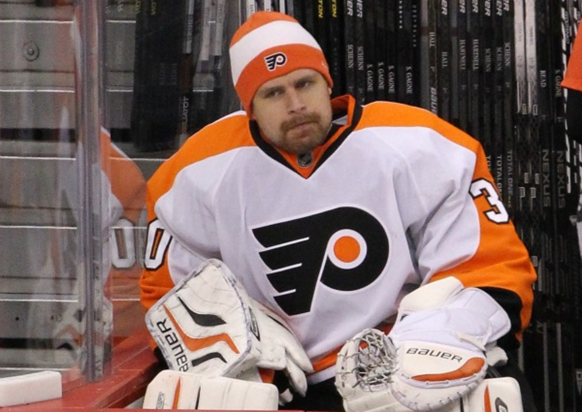 Ilya Bryzgalov struggled on and off the ice in Philadelphia. (Marianne Helm/Getty Images)