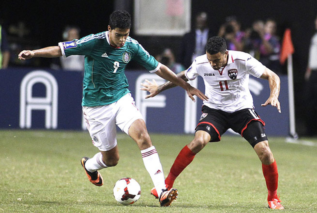 Raul Jimenez (left) provided Mexico with a late winning goal to help El Tri move on to the next round.