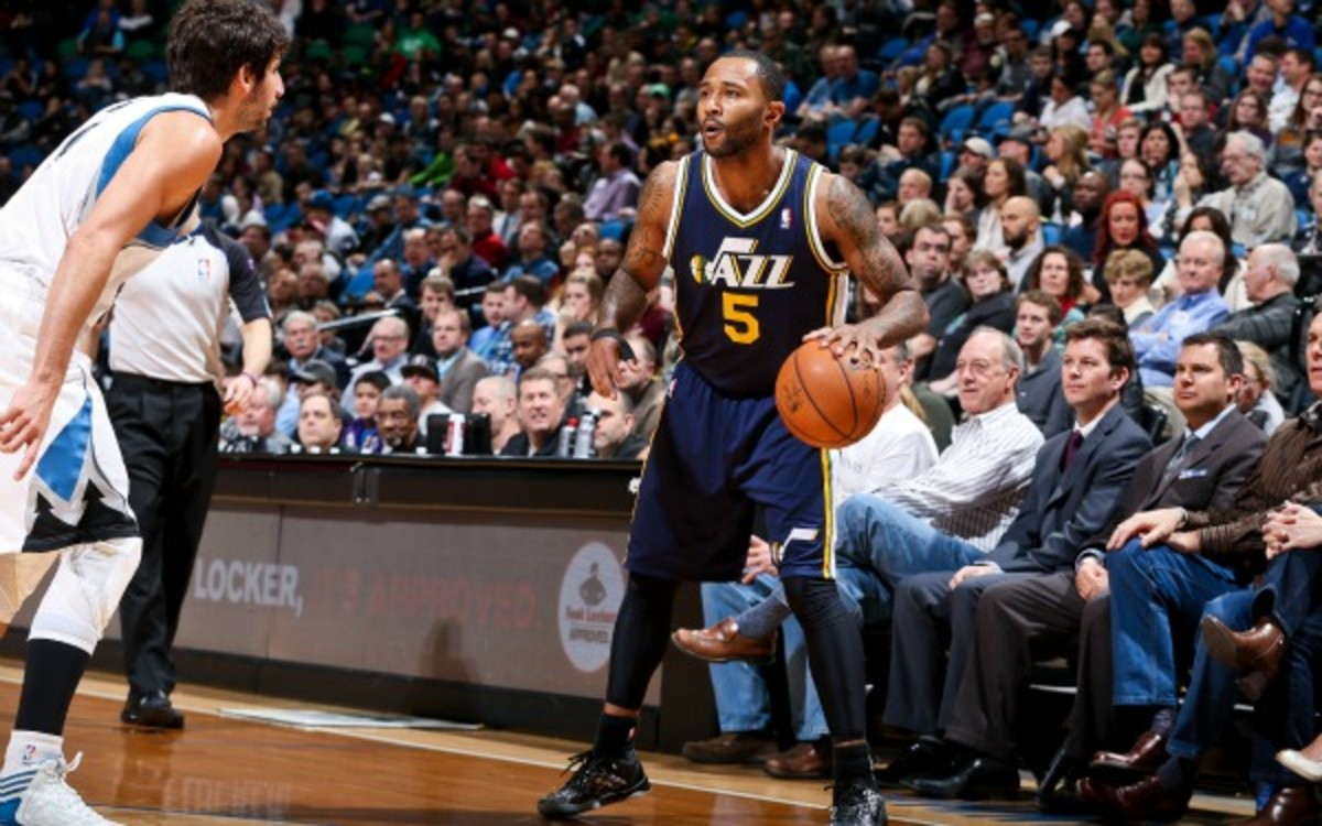 Mo Williams will re-sign with the Jazz only if he doesn't lose his spot to rookie Trey Burke (David Sherman/Getty Images)